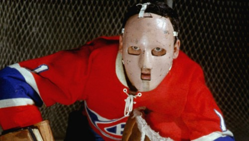 Jacques Plante sports the original goalie mask.  He refused to take it off after being hit in the face with a puck and changed the goaltender's gear for good. (Photo courtesy nhl.com)