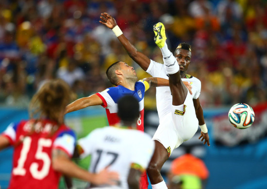 Jun 16, 2014; Natal, BRAZIL; USA forward Clint Dempsey (left) is kicked in the face by Ghana defender John Boye in the first half during the 2014 World Cup at Estadio das Dunas. (Photo by Mark J. Rebilas-USA TODAY)