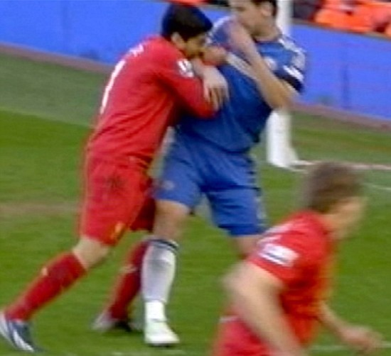 Replay of Liverpool striker Luis Suarez biting into the arm of Chelsea defender Branislav Ivanovic during their premiership match earlier on Tuesday. (AP photos)